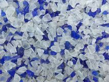 Decorative small blue shards of glass, close-up. Decorative small blue shards of glass as a background royalty free stock photography