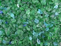Decorative small green and turquoise shards of glass, close-up. Decorative small green an turquoise shards of glass as a background stock photos