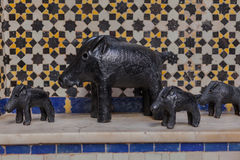 Decorative small pigs. Decorative small wild pigs, arranged in a row Stock Photo