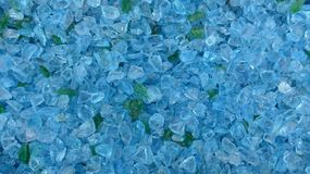 Decorative small turquoise shards of glass, close-up. Decorative small turquoise shards of glass as a background royalty free stock images
