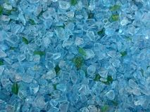 Decorative small turquoise shards of glass, close-up. Decorative small turquoise shards of glass as a background stock photos