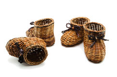 Decorative small  wicker shoes Royalty Free Stock Photography