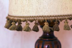 Decorative small wooden lamp with cloth top Royalty Free Stock Image