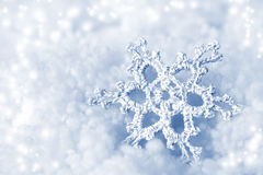 Decorative snowflake. On blue background Royalty Free Stock Photos