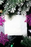 Decorative snowflake white and pink on black background. Christmas greeting card. Copy space. Top view. Stock Image