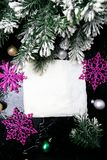Decorative snowflake white and pink on black background. Christmas greeting card. Copy space. Top view. Royalty Free Stock Photography