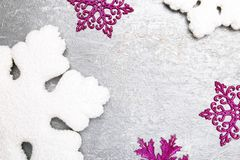 Decorative snowflake white and pink on grey background. Christmas greeting card. Copy space. Top view. Royalty Free Stock Photography