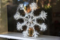 Decorative snowflake by the window Stock Photography