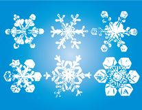 Decorative snowflakes. Illustration of six different decorative white snowflakes with blue background Royalty Free Illustration