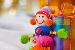 Decorative snowman with present box Stock Images