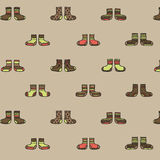 Decorative socks seamless pattern on a beige background. Vector illustration Royalty Free Stock Image