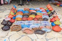 Decorative souvenir dishes. Decorative color dishes and pots at souvenir shop at oriental marketplace stock images