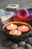 Decorative spa still life with candles, soap, flower and towels Stock Photography