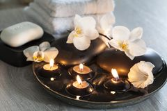 Decorative spa still life with soap, towels, orchid flowers and candles Stock Image