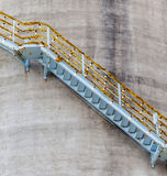 Decorative stairway on exterior of refinery storage tank for pet Royalty Free Stock Photo