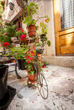 Decorative stand for flower pots on street Stock Photo