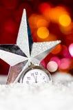 Decorative star and clock Stock Photo
