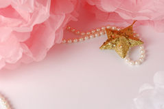 Decorative star, pearl beads and pink and white pom pom. Greeting or invitation card with copyspace Stock Image