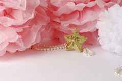 Decorative star, pearl beads and pink and white pom pom. Greeting or invitation card with copyspace Royalty Free Stock Image