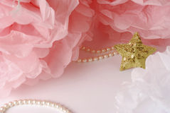 Decorative star, pearl beads and pink and white pom pom. Greeting or invitation card with copyspace Stock Photos