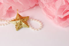 Decorative star, pearl beads and pink and white pom pom. Greeting or invitation card with copyspace Royalty Free Stock Photography