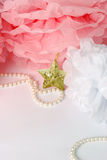 Decorative star, pearl beads and pink and white pom pom. Greeting or invitation card with copyspace Stock Photography