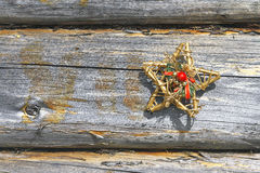 Decorative star and wooden wall Royalty Free Stock Images