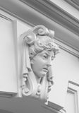 Decorative statue of a woman on facade Royalty Free Stock Photo