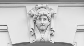 Decorative statue of a woman on facade Royalty Free Stock Image