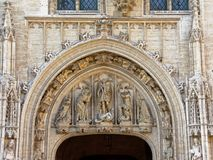 Decorative arch with statues above a door of the townhouse of Brussels, Belgium Royalty Free Stock Images