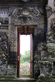 Decorative stone doorway of Pura Kehen Temple in Bali. Decorative doorway at entrance at Pura Kehen temple in Bali, Indonesia royalty free stock images