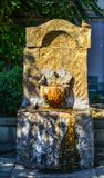 Decorative stone drinking water fountain royalty free stock image