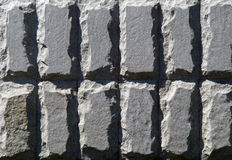Decorative stone texture. Texture of sunlit decorative stones, rectangle shaped and roughly hewn by the sides Royalty Free Stock Image