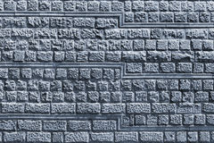 Decorative stone tiles in a wall. Royalty Free Stock Photography