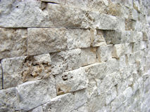 Decorative stone  wall. Wall built of blocks of calcite arranged in neat rows Stock Photography