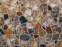 Decorative Stone Wall. A decorative rich textured large area decorated stone wall Stock Image