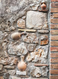 Decorative stone wall texture with pottery pots Stock Photography