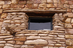 Decorative stone wall with window Royalty Free Stock Photo