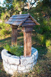 Decorative stone well in the park Stock Photos