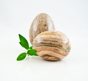Decorative stones in the form of egg. On a white background Royalty Free Stock Photography