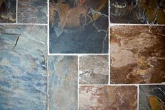 Decorative stonework with colorful slate tiles Stock Images