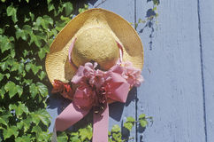 Decorative straw hat on door. Decorated straw hat nailed onto a door Royalty Free Stock Images