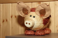 Decorative straw pig. In a wooden house Stock Photos