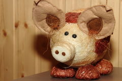 Decorative straw pig. In a wooden house Stock Photography