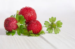 Decorative strawberries on white table stock image