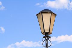 Decorative Street lamp on the background of the blue sky Stock Photo