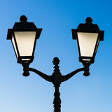 Decorative street lamp and blue sky Royalty Free Stock Photography