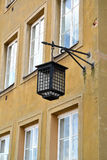 The decorative street lamp on a building wall. Warsaw, Poland Royalty Free Stock Photos
