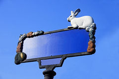 Decorative street name plaque with the figure of a rabbit Royalty Free Stock Photos