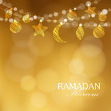Decorative string. Hanging moon, stars, balls. Festive golden glitter blurred background.Ramadan Kareem greeting card. Decorative string. Hanging moon, stars Stock Photography